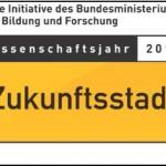 Logo des Wissenschaftsjahres 2015, gelbes Schild