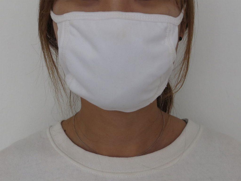 halbes Gesicht mit Mundschutz