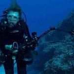 Unterwasser-Fotografie von Sylvia Earle im Tauchanzug vor einem Korallenriff