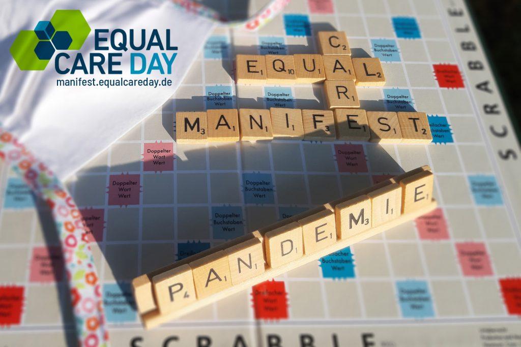 Scrabble Zeichen mit Equal Care Manifest und Pandemie beschriftet