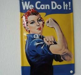 """Bild, auf dem eine Frau zu sehen ist, die die Ärmel hochkrempelt und """"We can do it!"""" sagt."""