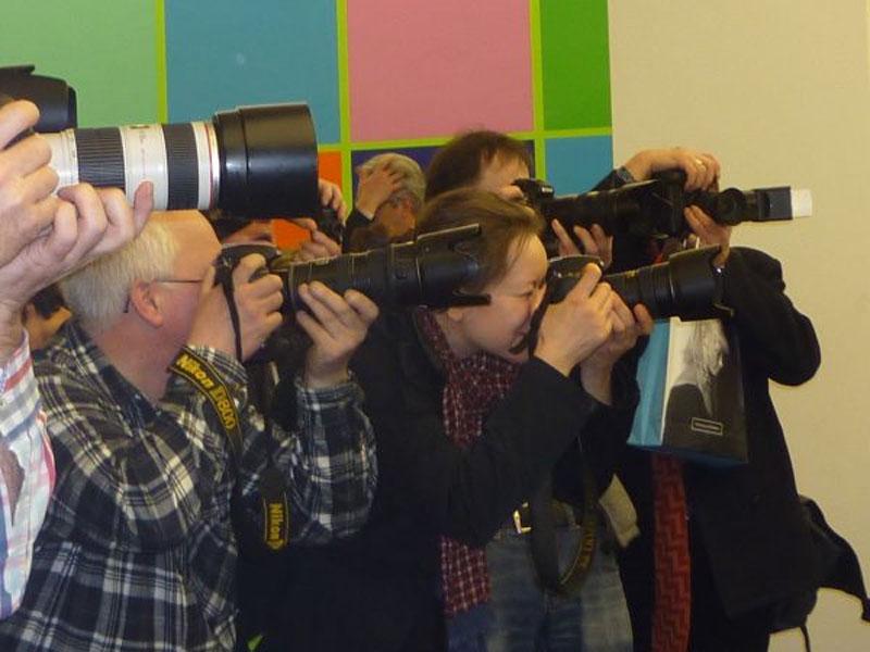 Viele Fotografen in Aktion