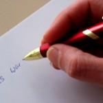 Hand  mit Kugelschreiber